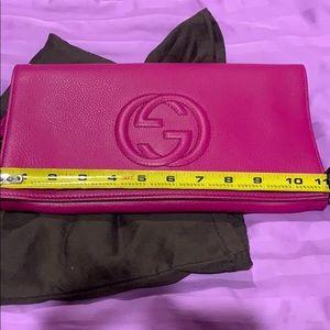 Brand new Gucci clutch in pink magenta